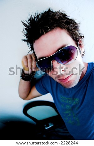 male model poseing, (white,blue lights)- (soft Focus for effect) - stock photo