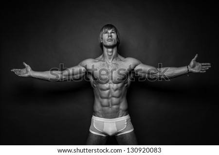 Male model posing in a studio - stock photo