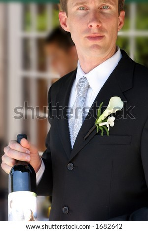 Male model wedding groom with wine. - stock photo