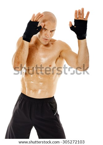 Male muay thai or kickbox fighter in guard stance isolated on white - stock photo