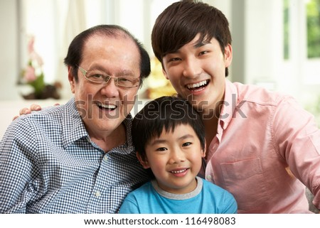 Male Multi Genenration Chinese Family Group Relaxing At HomeTogether - stock photo
