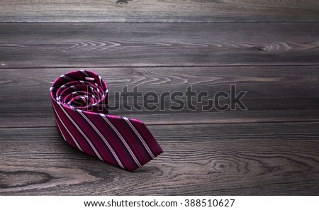 Male necktie on wooden table background - stock photo