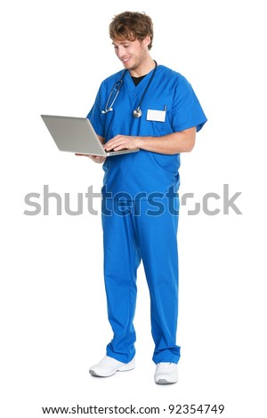 Male Nurse / doctor working on laptop pc computer smiling happy standing isolated in full length on white background. Young medical professional man. - stock photo