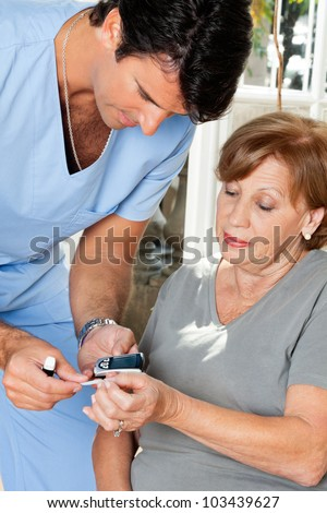 Male nurse measuring glucose level blood test using glucometer and sample strip - stock photo