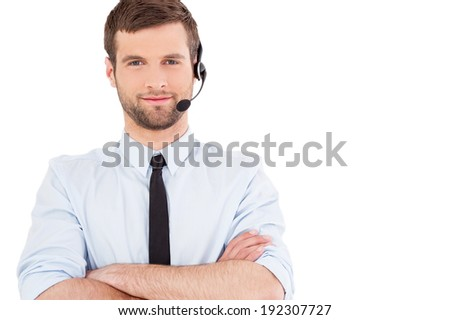 Male operator. Handsome young man in formal wear and headset looking at camera and smiling while standing isolated on white background - stock photo