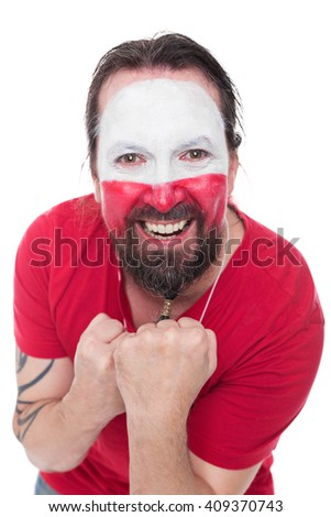 male painted polish soccer fan looks happy, isolated on white - stock photo