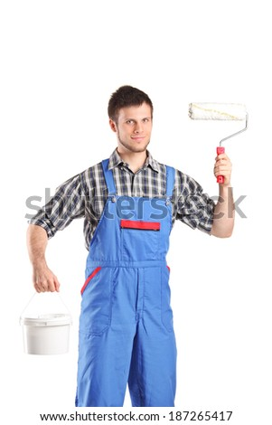 Male painter holing a paint roller and color bucket isolated on white background - stock photo