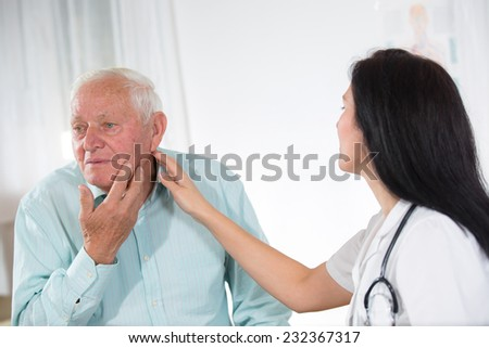 Male patient tells the doctor about his health complaints  - stock photo