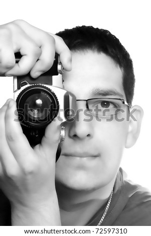 male photographer with camera isolated on white - stock photo