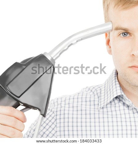 Male pointing black color fuel pump nozzle at his head - 1 to 1 ratio - stock photo