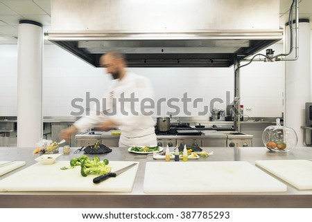 Male professional chef cooking in a kitchen. - stock photo