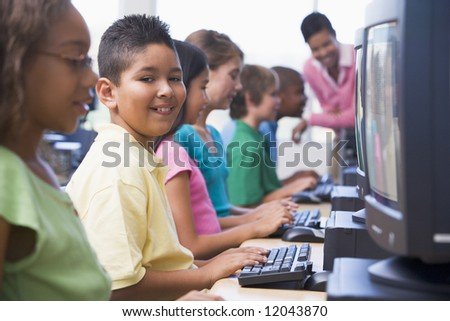 Male pupil in elementary school computer class - stock photo