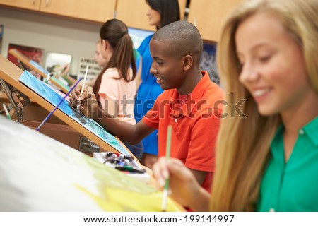 Male Pupil In High School Art Class - stock photo