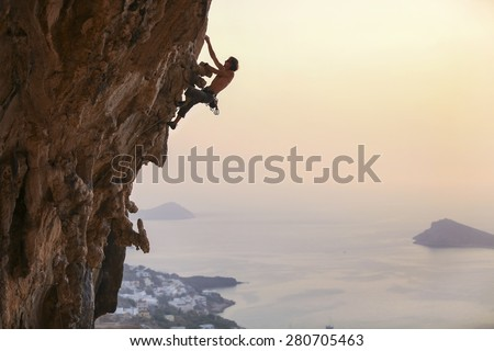 Male rock climber at sunset, Kalymnos Island, Greece - stock photo