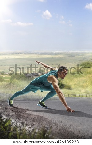 Male runner sprinting during outdoors training for marathon run - stock photo