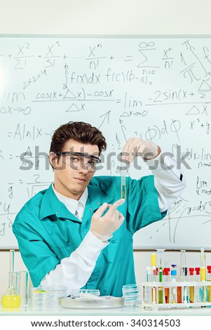 Male scientist working in the life science research laboratory (bacteriology, chemistry, genetics, forensics). - stock photo