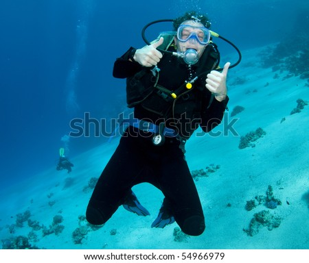 male scuba diver enjoying the dive - stock photo