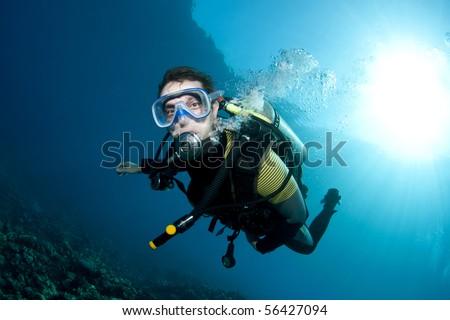 male scuba diver underwater with sunball - stock photo
