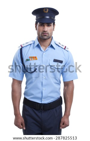 Male security guard standing over white background - stock photo
