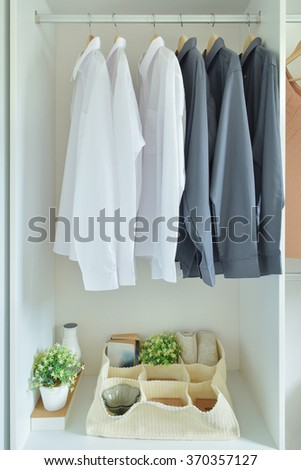 Male shirts hanging in wardrobe - stock photo