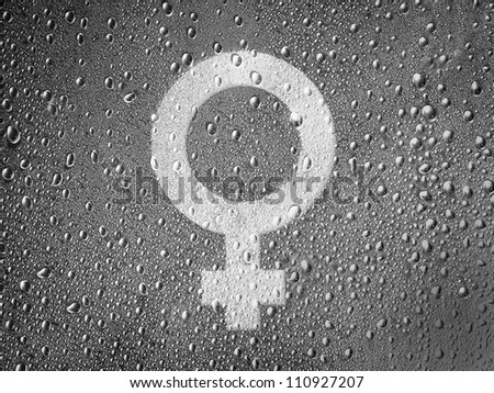 Male sign drawn at metal surface covered with rain drops - stock photo