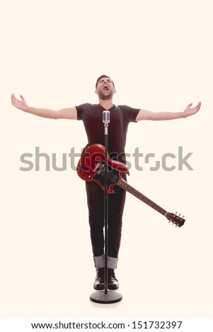 male singer singing, performing with guitar - stock photo