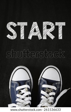 Male sneakers with start word. Male sneakers with start word on the back background - stock photo