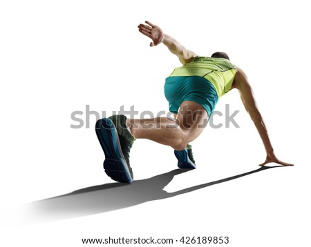 male sprinter running on isolated background - stock photo