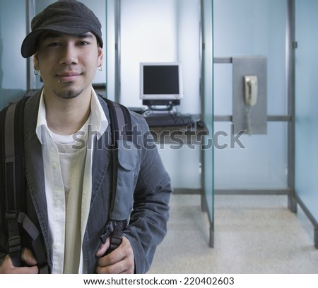 Male student next to computer - stock photo