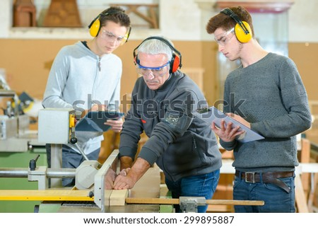 Male students in a woodwork class - stock photo