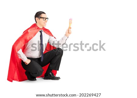 Male superhero holding an ice cream isolated on white background - stock photo