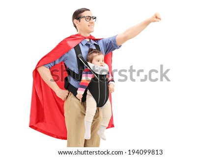 Male superhero with raised fist carrying a baby isolated on white background - stock photo