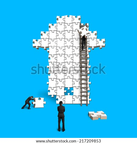 male teamwork for puzzles in arrow shape isolated on blue - stock photo