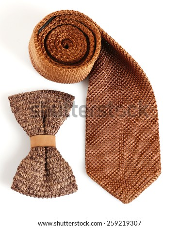 Male tie and bow tie isolated on white - stock photo