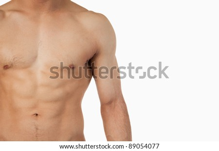 Male toned abs against a white background - stock photo