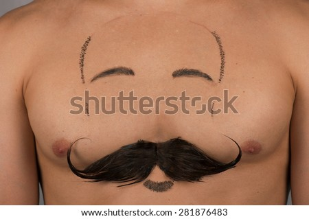 male torso with moustache and beard at chest - stock photo