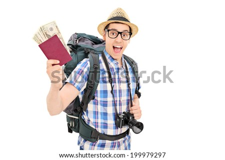 Male tourist holding his passport full of money isolated on white background - stock photo