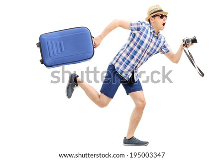 Male tourist rushing with his baggage and camera in hand isolated on white background - stock photo