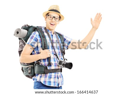 Male tourist with backpack waving with his hand isolated on white background - stock photo