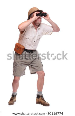 Male traveler with his binocular. Studio shot isolated on white background - stock photo