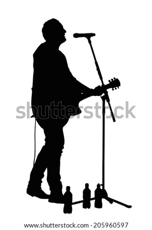 Male Vocalist Singing into Microphone with Guitar Silhouette - stock photo