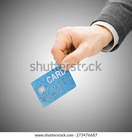 Male with credit card in hand - paying concept - stock photo