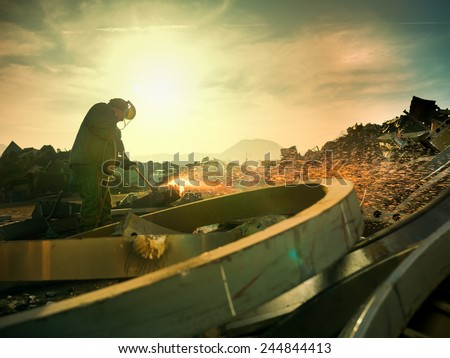 male worker wearing protective equipment welding metal outdoors. copy space available - stock photo