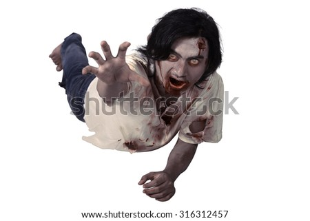 Male zombie crouching on the floor isolated over white background - stock photo