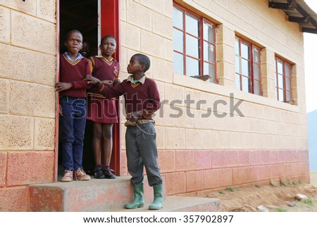 Malealea, Lesotho - August, 27th, 2015: local school; students in front of their school. - stock photo