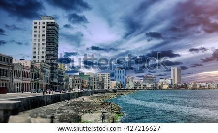 Malecon Skyline Dramatic Havana Cuba. Skyline of Havana, Cuba and the famous Malecon landmark street along the coast. - stock photo