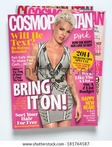 MALESICE, CZECH REPUBLIC - MARCH 15, 2014: stack of magazine Cosmopolitan, on top Middle East edition, issue January 2014 with Pink on cover, on display in Malesice, Czech republic in March 2014  - stock photo