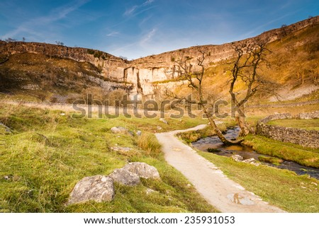 Malham Cove in Malhamdale / Malham Cove in Malhamdale is a popular tourist attraction of the Yorkshire Dales National Park - stock photo