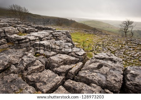 Malham Dale from limestone pavement above Malham Cove in Yorkshire Dales National Park - stock photo