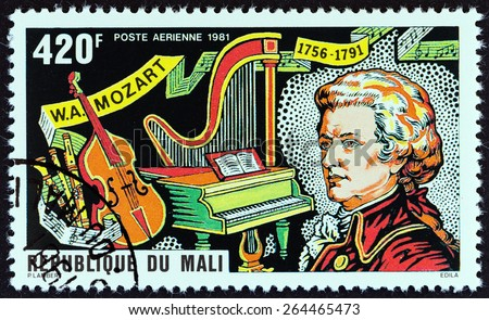 """MALI - CIRCA 1981: A stamp printed in Mali from the """"225th Birth anniversary of Mozart """" issue shows Mozart and Musical Instruments, circa 1981.  - stock photo"""